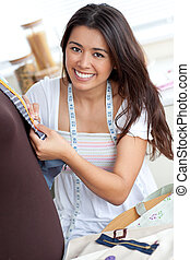 Delighted young woman working in a store