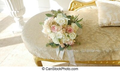 Delightful bouquet of delicate white and cream roses, slow...