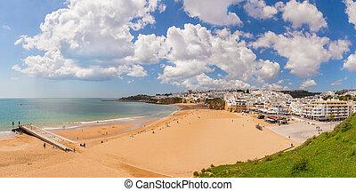 Delightful Spring panorama Albufeira beach fishermen. Portugal Algarve.