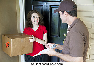 Delivering a Package - Delivery man brings a package to a ...