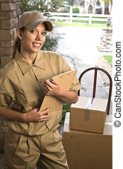 Delivering package - Young woman delivering shipment or ...