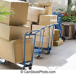 Delivering parcels boxed goods supplies from truck lorry