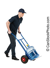Delivering water. Cheerful young going carrying a hand truck with water jug on it while isolated on white