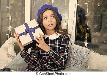 delivery christmas gifts. Christmas is the time to please. happy new year. curiousgirl celebrate winter holiday. christmas time. Cute little child girl with xmas present. interesting what is inside