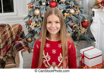delivery christmas gifts. happy new year. happy little girl celebrate winter holiday. christmas time. Cute little child girl with xmas present. Taking advantages of Christmas sales. favorite sweater