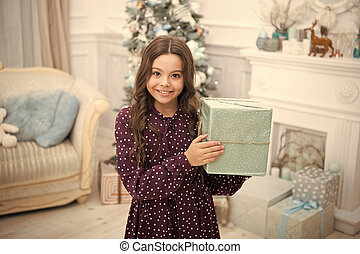 delivery christmas gifts. happy new year. happy little girl celebrate winter holiday. christmas time. Cute little child girl with xmas present. New Year is coming. What is inside