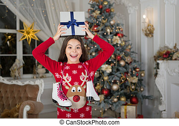 delivery christmas gifts. happy new year. happy little girl celebrate winter holiday. Winter holidays sales. christmas time. Cute little child girl with xmas present