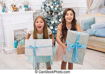 delivery christmas gifts. little children girls with xmas present. happy new year. happy little sisters celebrate winter holiday. christmas time. Family. All I want for Christmas. this is for you
