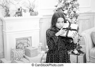 delivery christmas gifts. sad little girl celebrate winter holiday. christmas time. happy new year. Cute little child girl with xmas present. Happy New 2019 Year. Checking what is inside