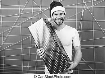 delivery christmas gifts. The morning before Xmas. man enjoy the holiday. happy man in santa hat hold christmas present. Winter holidays sales. Are you ready. New year new goals