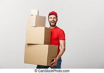 Delivery Concept: Man hardly carries the cardboard boxes, isolated on white background. Concept of difficult career of a delivery man