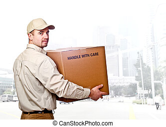 delivery - confident man holding a box