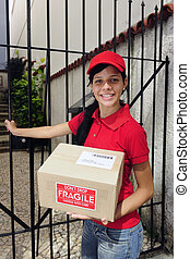 delivery courier or mailman delivering package - young...