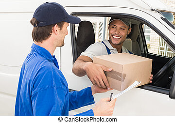 Delivery driver handing parcel to customer in his van ...
