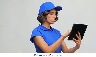 delivery girl in blue uniform with tablet computer - mail ...