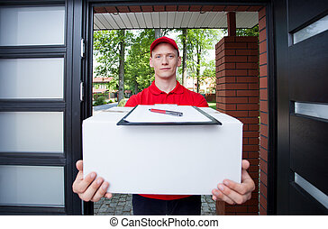 Delivery guy handing in parcel - Delivery man giving a...