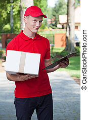 Delivery guy holding a package