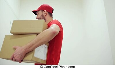 happy man delivering parcel boxes to customer home -...