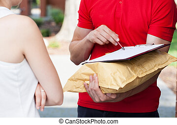 Delivery man asking for a signature