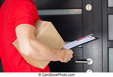 Delivery man at front door - Delivery guy waiting at front ...