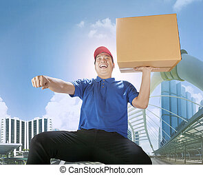 delivery man carrying card box with haapiness emotion in city building ,for delivering and courier business