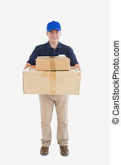 Delivery man carrying stack of cardboard packages - Portrait...