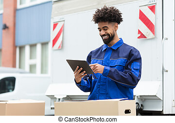 Delivery Man Checking His Order On Digital Tablet