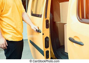 Delivery man closing van.