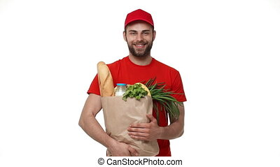 Delivery man delivering package of grocery.