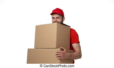 Delivery man delivering package to a home with heavy boxes.