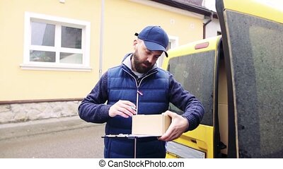 Delivery man delivering parcel box to recipient. - Delivery...