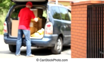 Delivery man during work - Delivery man with cardboard...