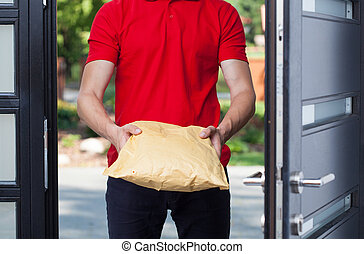 Delivery man giving a package