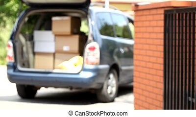 Delivery man holding cardboard pack