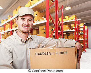 delivery man in warehouse - delivery man with parcel in...