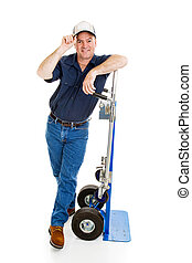 Deliver man or mover leaning on his dolly and tipping his hat. Full body isolated on white.