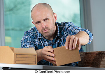 delivery man preparing small cartons