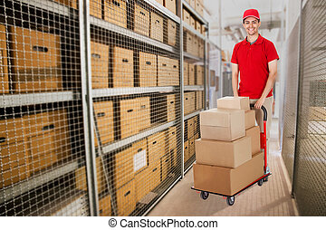 Delivery Man Pushing Cart Full Of Boxes In Warehouse