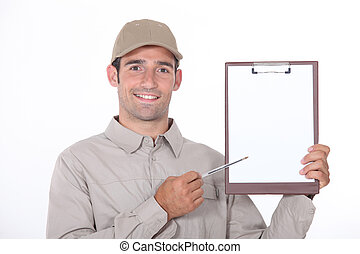 delivery man showing a paper to sign