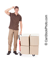 Delivery Man Standing Near Boxes And Hand truck