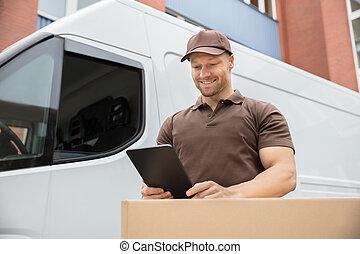Delivery Man Using Digital Tablet