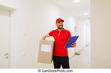 delivery man with box and clipboard in corridor