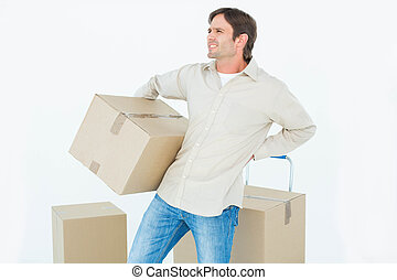 Delivery man with cardboard box - Upset delivery man with...