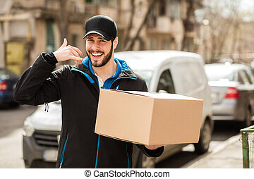 delivery man with cardboard in hands