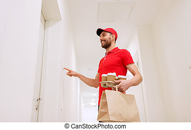 delivery man with coffee and food ringing doorbell