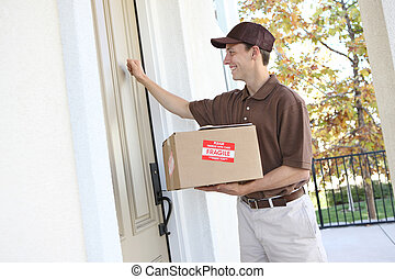 Delivery Man with Package - A handsome young delivery man...