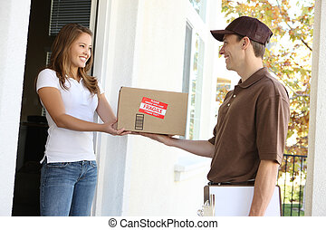 Delivery Man with Package - A handsome young delivery man ...