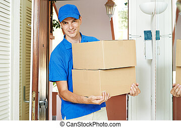 delivery man with parcel box indoors