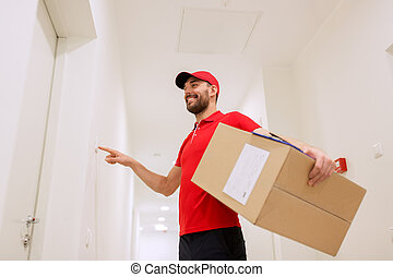 delivery man with parcel box ringing doorbell - delivery,...