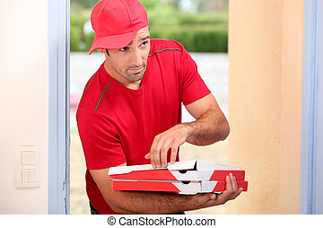 Delivery man with pizza boxes